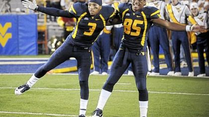 Wacky finish in Big East puts WVU in Orange Bowl