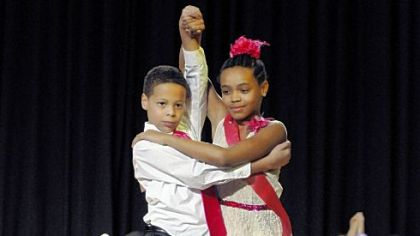 Local fifth-graders cut rug for dance competition