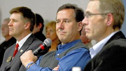 Romney targets auto bailout in battle for Michigan
