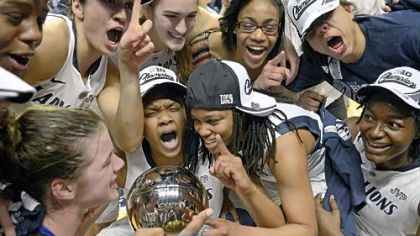 Penn State players celebrate the team's 84-66 win Monday against Ohio State in University Park that gave the Nittany Lions at least a share of the Big Ten title.