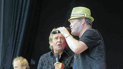 The Monkees, (from left, Peter Tork, Davy Jones and Mickey Dolenz during a performance here in 2011.