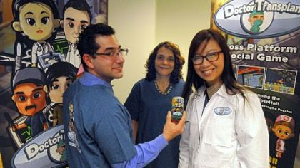The Doctor Transplant team: from left, Howard Degenholtz and Abby Resnick, project director, both with the University of Pittsburgh; and Geraldine Yong, CEO of MogiMe, which helped to design the game.