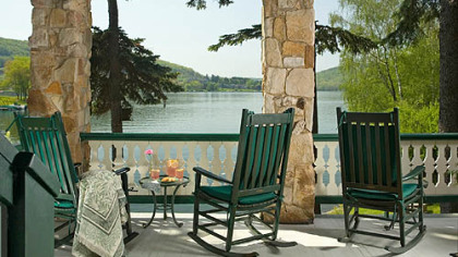 Rockers on the wraparound porch of Lake Pointe Inn provide a peaceful view of Deep Creek Lake in Maryland.