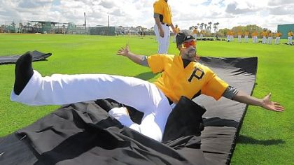 Pittsburgh Pirates Andrew McCutchen mugs for the camera during sliding drills at Pirate City Bradenton Florida