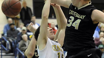 Gateway's Thomas Kromka blocks a shot by Central Catholic's Mike Anselmo.