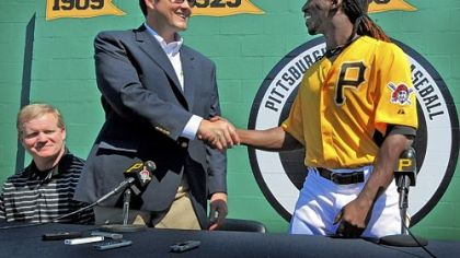Pirates owner Bob Nutting, middle, and Andrew McCutchen shake hands at the news conference Tuesday in Bradenton, Fla., announcing McCutchen's $51.5 million, six-year contract. At left is general manager Neal Huntington.