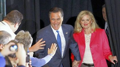 Republican presidential candidate, former Massachusetts Gov. Mitt Romney, and his wife, Ann, greet supporters as they arrive at their Super Tuesday primary night rally in Boston.