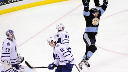 Pascal Dupuis, right, celebrates the first of his two goals Wednesday night.