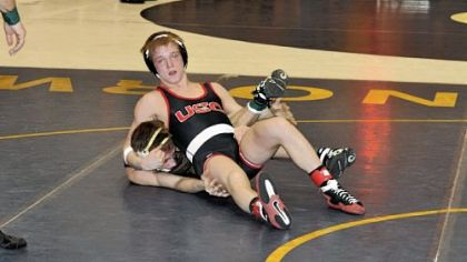 Upper St. Clair's Mackenzie McGuire, top, was a 2-1 winner against Greensburg Salem's Tyler Reinhart in the semifinals of the WPIAL/Southwest Region Class AAA tournament Saturday at Norwin High School. McGuire won the 132-pound title later that day, defeating Franklin Regional's Josh Shields in the final.