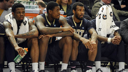Pitt's Nasir Robinson, left, Dante Taylor, J.J. Moore and Ashton Gibbs watch the final seconds of the Panthers' loss to Georgetown Wednesday in the second round of the Big East tournament at Madison Square Garden.