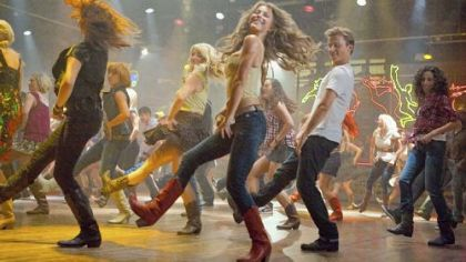 "Julianne Hough, center, and Kenny Wormald lead the way in ""Footloose."""
