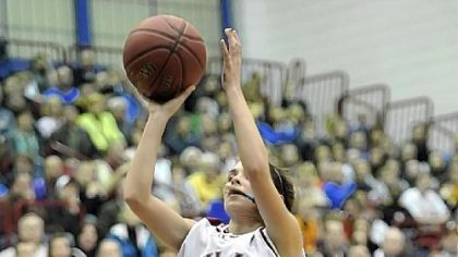 Oakland Catholic's Bobbi Baker gets off a shot gainst Mt. Lebanon in the WPIAL Class AAAA championship at the Palumbo Center Friday.
