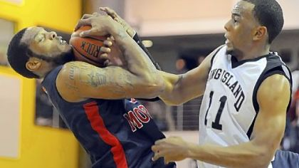 Robert Morris' Mike McFadden grabs a loose ball away from Long Island's Brandon Thompson in the first half.