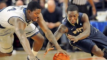 Tray Woodall, right, goes to the floor after a loose ball with Georgetown's Henry Sims in the first half.