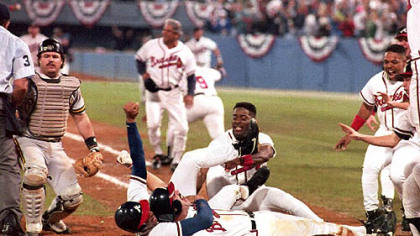 Sid Bream gets hugged by teammate David Justice on Oct. 14, 1992, after Bream scored the winning run in the bottom of the ninth, to clinch the National League Championship Series against the Pirates in Atlanta.