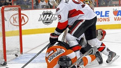 Philadelphia's Wayne Simmonds lies on the ice after a shot by teammate Brayden Schenn caromed off his face and into the net for a goal.