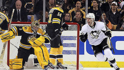 Pascal Dupuis, right, celebrates the first of Sidney Crosby&#039;s two goals against Bruins goalie Marty Turco Tuesday.