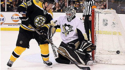 Brent Johnson makes a save against Boston&#039;s Brad Marchand -- one of his 26 in the Penguins&#039; 5-3 victory.