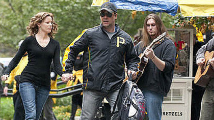 "Made right here: Elizabeth Banks and Russell Crowe in ""The Next Three Days."" (Bonus: Pirates product placement.)"