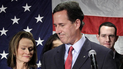 Former Sen. Rick Santorum turns to his wife Karen, left, after announcing he is suspending his candidacy for the presidency.