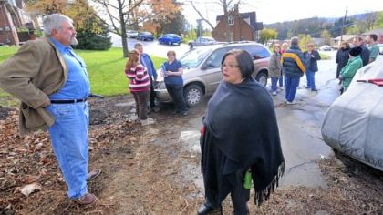 Bridgeville Councilman Joe Colosimo, left, and his wife, Deb, stand at the end of Main Street with others who do not want the street used to access a planned housing development in Upper St. Clair.