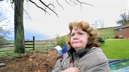 Caryn Falcone, who has lived on Pesavento Drive in Bridgeville for 40 years, opposes the opening of Main Street at its dead-end, shown behind her, to create an access road for the planned Bedner Farms housing development in neighboring Upper St. Clair.