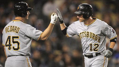 Pirates' Clint Barmes is congratulated by teammate Erik Bedard after hitting a solo home run.