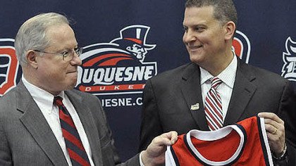 Jim Ferry the former coach of LIU Brooklyn  poses with Duquesnes University President Dr. Charles Dougherty. Ferry will be the 16th head coach  in the 95-year history of Duquesne basketball.