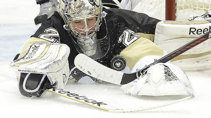 Goalie Marc-Andre Fleury makes a save in the second period of Game 2 last night at Consol Energy Center. Fleury was under siege again as the Penguins lost, 8-5.