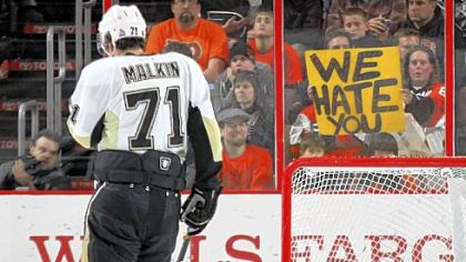 Evgeni Malkin skates by as Flyers fans let their opinions be known at a game in February at the Wells Fargo Center in Philadelphia.
