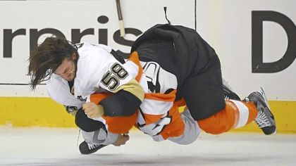 Kris Letang takes down the Flyers' Kimmo Timonen in what was a heated game Sunday in Philadelphia. The Penguins lost, 8-4, to go down, 3-0, in the series.