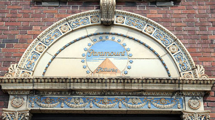 The ornate terra cotta logo of Paramount Films over the entrance of the Paramount building.