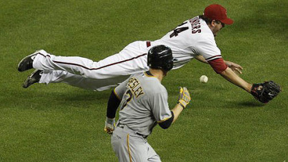 Arizona Diamondbacks&#039; Joe Saunders tries to field a bunt by Pirates&#039; Alex Presley during the fifth inning. Presley reached on an infield hit on the play.