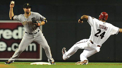 Pirates&#039; Neil Walker throws the ball to first base as Chris Young  attempts to break up the double play.
