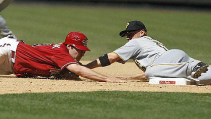 Pirates&#039; Clint Barmes tags Arizona Diamondbacks&#039; A.J. Pollock who slid past second base on a steal-attempt during the seventh inning.