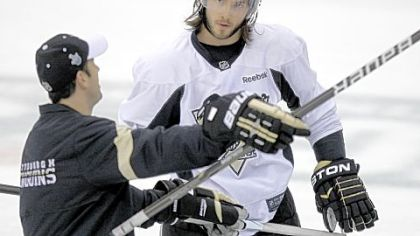 Kris Letang listens to assistant coach Todd Reirden at practice Tuesday.