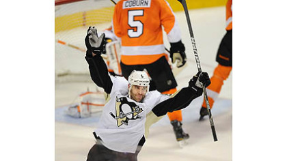 The Penguins&#039; Pascal Dupuis celebrates his goal against the Flyers.