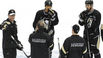 Penguins head coach Dan Bylsma (left) calls a drill during the team's practice for tonight's Game 5.