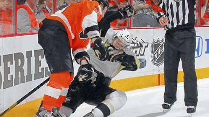 Zac Rinaldo, left, was not suspended for this hit on Zbynek Michalek in the second period Wednesday.