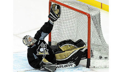 Penguins goalie Brent Johnson practices making glove saves during Thursday's practice.