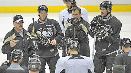 The Penguins gathered around head coach Dan Bylsma, left, as they practiced at the Consol Energy Center today before heading to Philadelphia for tomorrow&#039;s Game 6.