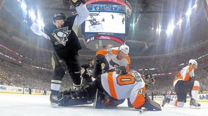 Sidney Crosby watches a puck shot by teammate Steve Sullivan head into the Philadelphia Flyers net in the first period of Game 5 of the team&#039;s first-round Stanley Cup playoff series at Consol Energy Center.