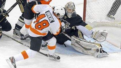 Marc-Andre Fleury makes a save on Danny Briere in Game 5 Friday. Fleury made 24 saves on 26 shots in the win.