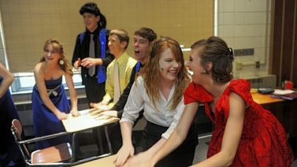 "Lisa Lujetic, second from right, and Jamie Coulson, right, get pumped before Elizabeth Forward High School's performance of ""The Wedding Singer"" on Friday."
