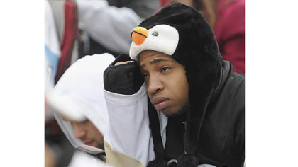 University of Pittsburgh student Manny Moorer of Charlotte, N.C. frowns at the Penguins' declining fortunes as fans gathered in the cold outside the Consol Energy Center to watch Game 6.