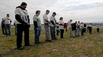 Volunteers observe a moment of silence in memory of those who died in the 9/11 terrorist attack before planting tree seedlings at the Flight 93 National Memorial in Stonycreek, Somerset County, on Saturday.