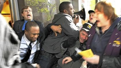 Protesters are pushed Wednesday while trying to enter the Au Bon Pain cafe at the EQT Plaza on Liberty Avenue, Downtown.