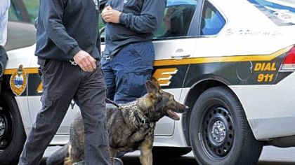Police dogs leave the Western Pennsylvania School for Blind Children April 12 after they were used to investigate a bomb threat at the institution on North Bellefield Avenue in Pittsburgh&#039;s Oakland neighborhood. The school is near the Pitt campus, which has received several dozen threats.