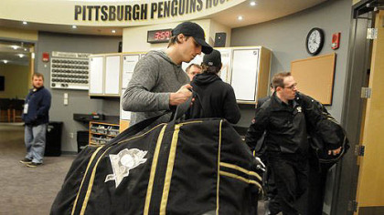 Penguins goalie Marc-Andre Fleury packs up his equipment in the Penguins locker room on Tuesday afternoon.