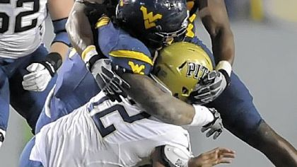 West Virginia's Bruce Irvin and Will Clarke sack Pitt's Tino Sunseri in the fourth quarter Friday.